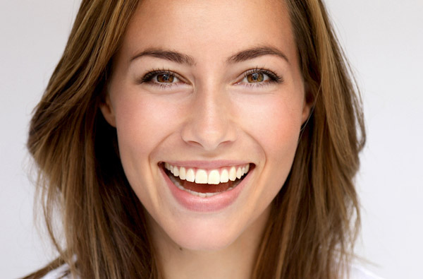 Beautiful woman smiling after a cosmetic dental procedure at McDonald DDS in Plano, TX
